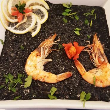 Black rice with squid and calamari